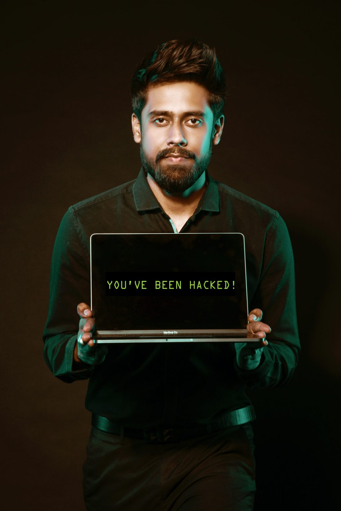 Man holding laptop showing you have been hacked trought your smart home devices